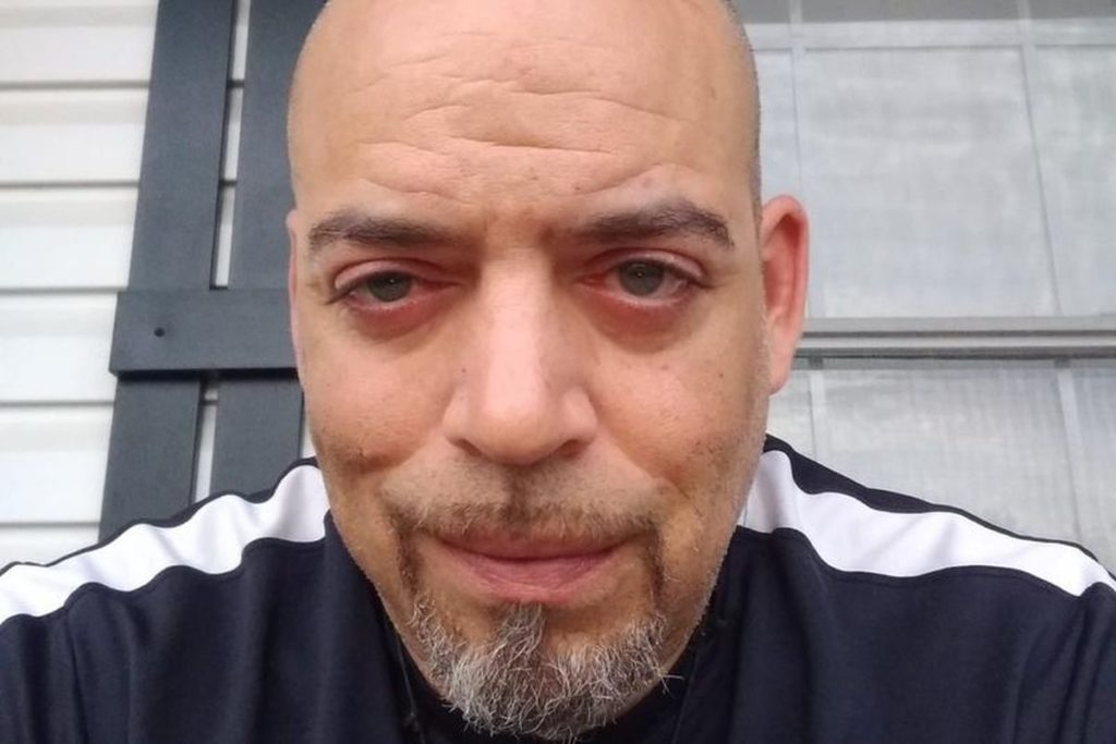 Black man shot and killed by police in his garage