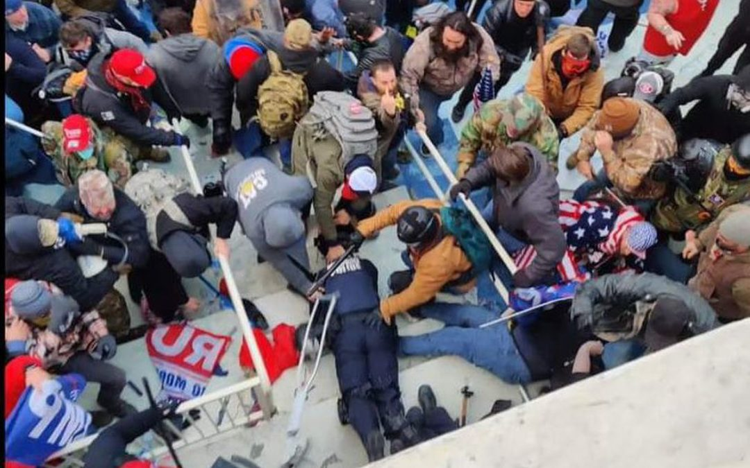 In a video, Trump rioters can be seen hitting cop who was on the ground